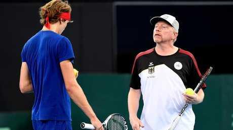 Boris Becker speaks to Alexander Zverev during Davis Cup practice.