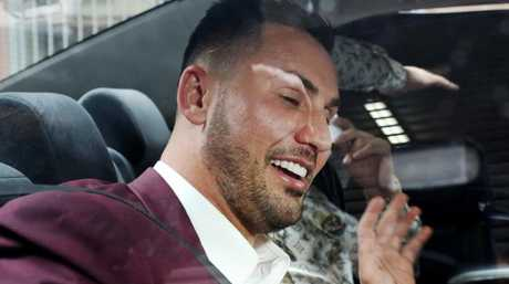 Mehajer in a taxi after being charged with allegedly assaulting a taxi driver with an eftpos machine.