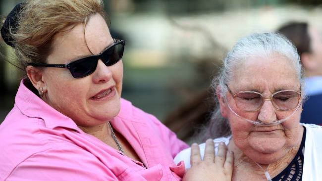Dallas Holland's partner, Tina Morley, and his mother Julie Reid outside the District Court in Brisbane today. Picture: Liam Kidston