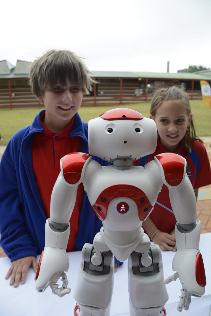 Vale View State School's Coby Smith and Bridget Pohlman with their robot at the launch of the Mayor's Telstra Technology Awards.