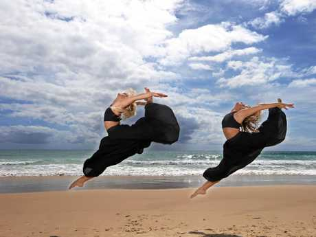 Sarah Quinn and Ashleigh Lyons are dancers and identical twins and work together at Lyons Studio. They are rehearsing at Elephant Rock, Currumbin.