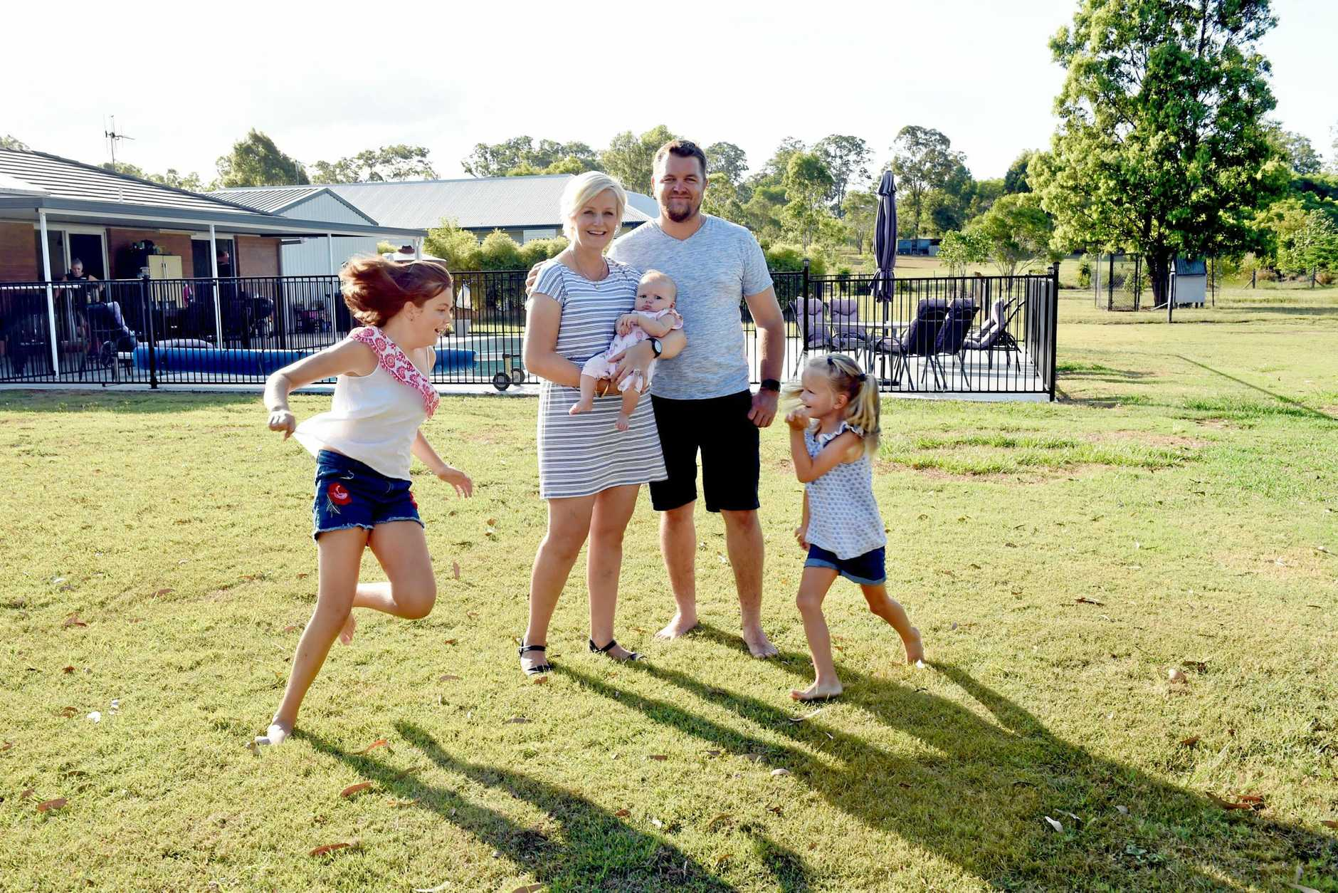OPEN SPACE: Tinana's Henderson Park promises a rural setting just minutes from town. Pictured is Iindah Road couple Emma and Chris Putney with Cailin, 11, Piper, 5 and 11-week-old Maggie.