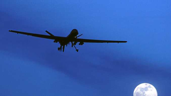 In this Jan. 31, 2010 file photo an unmanned U.S. Predator drone flies over Kandahar Air Field, southern Afghanistan, on a moon-lit night. (AP Photo/Kirsty Wigglesworth, File)