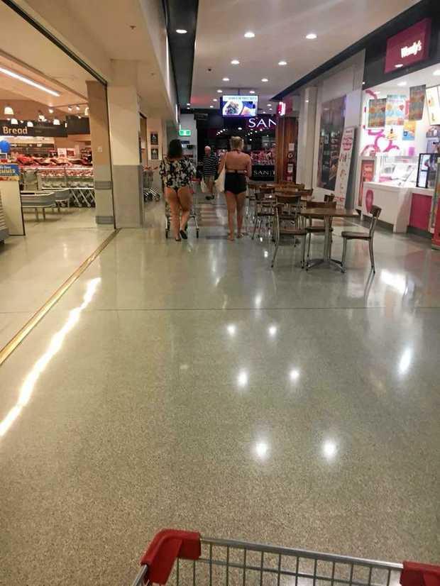 A Rockhampton shopper took this photo of two women in a shopping centre wearing bikinis which has split public opinion.