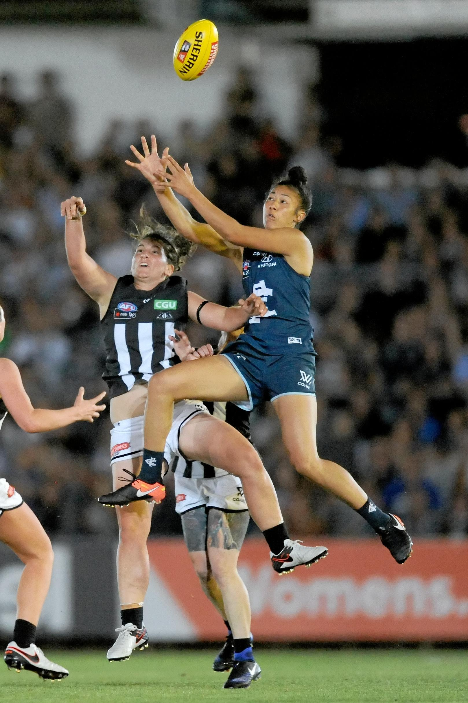Darcy Vescio of Carlton (right) wins the ball over Brittany Bonnici of Collingwood in the round one AFLW last season. The teams launch the second season on Friday.