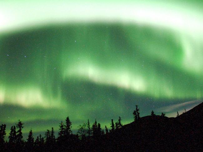 Earth's north magnetic pole is drifting from North America at such a clip that it could end up in Siberia. The shift could mean that Alaska may no longer be able to see the high-altitude shimmering displays of colourful lights called the aurora borealis. Picture: AP Photo/Anchorage Daily News, Evan R. Steinhauser, File