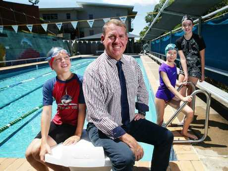 Principal Greg Cran with St Ita's Catholic Primary School students Riley Clarke, 10,   Isabella Byrne, 10 and Tess Mackinnon, 11. St Ita's school teaches their students to swim and to be safe around water. Picture: AAP Image/Claudia Baxter