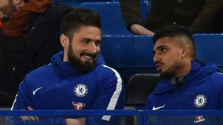 Newly-signed Chelsea striker Olivier Giroud (L) sits with the team before the English Premier League football match between Chelsea and Bournemouth