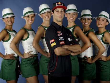 Formula One driver Daniel Ricciardo with Grid Girls in their outfits designed by in-house designer in Europe for Rolex. Picture: Supplied