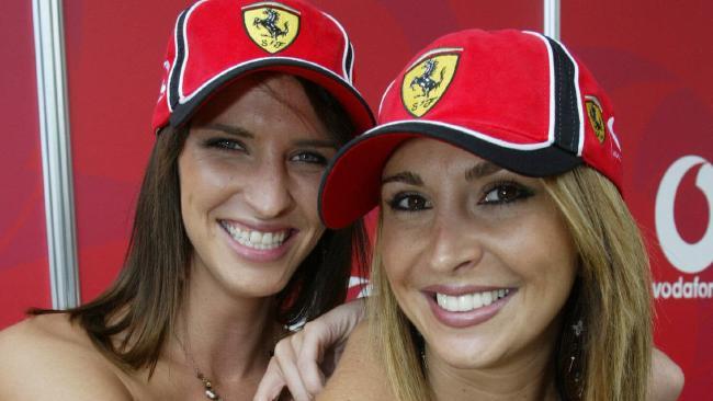 Jacinta Field (L) & Rosanna Faraci as Ferrari grid girls during Australian Formula One Grand Prix at Albert Park in Melbourne. Picture: Damien Horan.