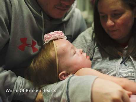 A heart-wrenching image of Adalynn and her parents. Picture: Suha Dabit/World of Broken Hearts