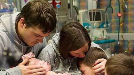 Adalynn's family surrounds her. Picture: Suha Dabit/World of Broken Hearts