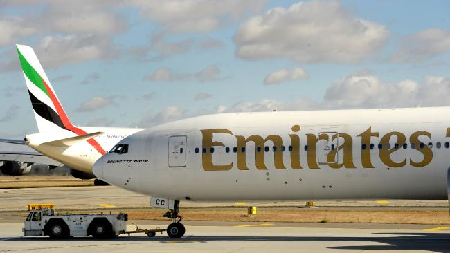 A man claims he was punched and bound by Emirates flight crew on a flight from Dubai to Chicago. Picture: Mike Keating