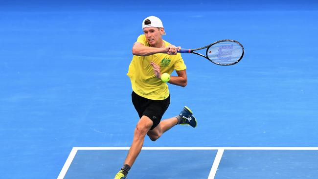 Australian Alex de Minaur is seen in action during a practice session at Pat Rafter Arena in Brisbane, Wednesday, January 31, 2018. The Davis Cup World Group First Round tie between Australia and Germany will take place on hardcourt at Pat Rafter Arena from February 2 to 4. (AAP Image/Dave Hunt) NO ARCHIVING, EDITORIAL USE ONLY