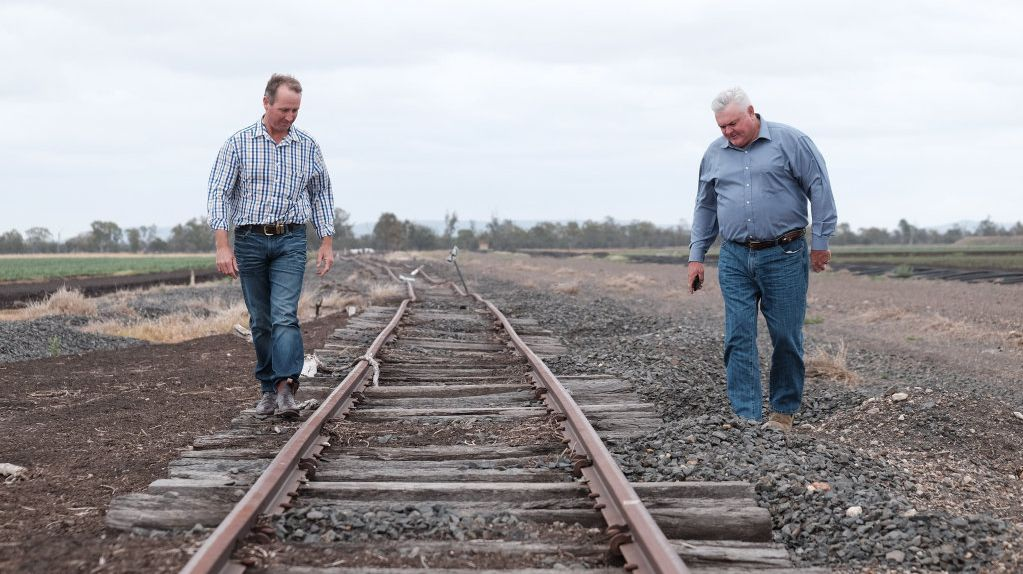 Jason Mundt (left) and Wes Judd (right) inspect the damaged rail line near Gilgai Lane, outside Pampas. The line was hit by the 2010, 2011, and 2013 floods.