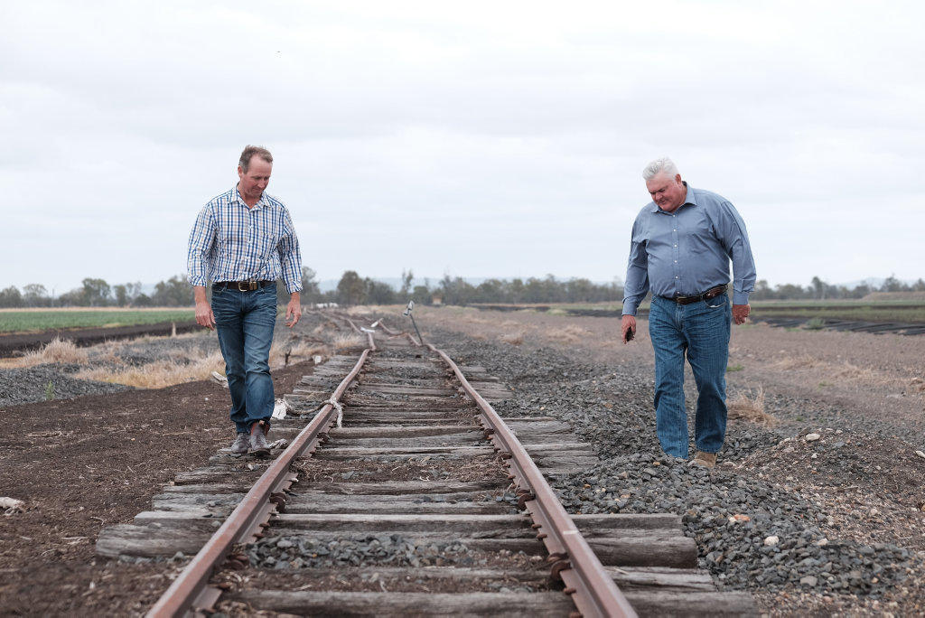 FLOOD DAMAGE: Farmers Jason Mundt (left) and Wes Judd inspect the damaged rail line near Gilgai Lane outside Pampas on the Condamine Floodplain.  The line was hit by the 2010, 2011, and 2013 floods.