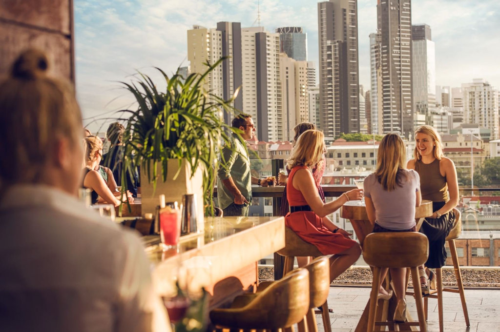 Grab a fancy cocktail at one of Brisbane's top rooftop bars, Eleven. Photo: Contributed