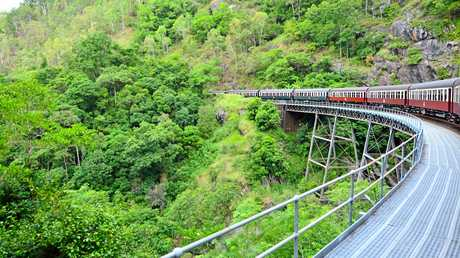 Kuranda Scenic Railway Rounding a bend on top of a bridge in the tropical north of Queensland Australia.