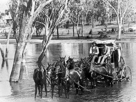 A Cobb & Co coach crosses a waterway on Old Gympie Rd at Kallangur. Date unknown.