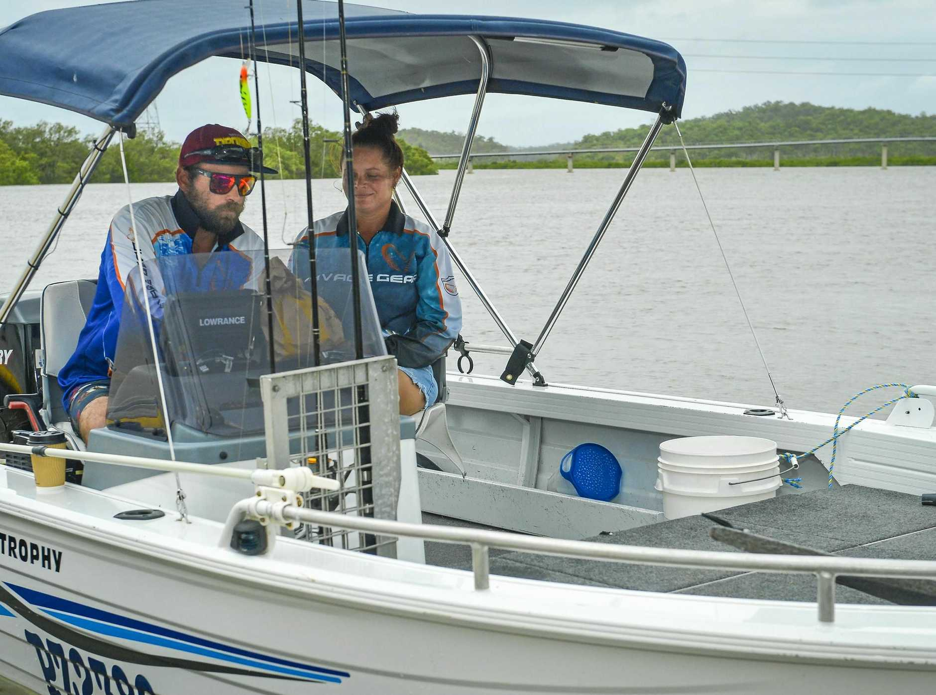 CATCH OF THE DAY: Sam and Jess Hall launching their boat at South Trees Inlet in Gladstone.