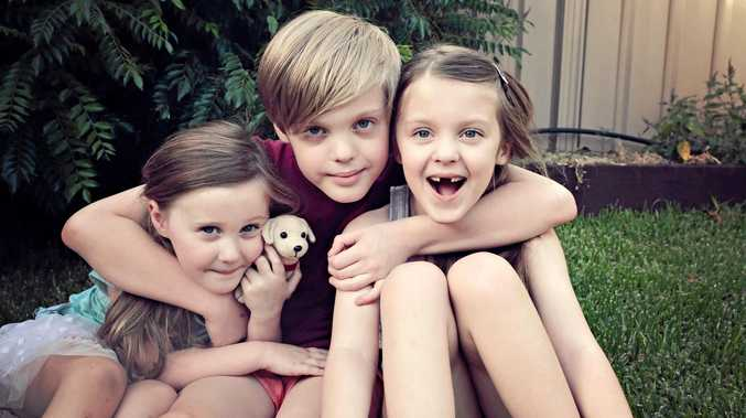 PUPPY LOVE: Little sister Paige, 4, Connor, 9, and Hayley Waldron, 6, can't wait to meet their Smart Pup Dougal.