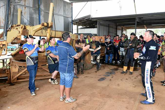 Maryborough speedway - rained out. Motorcycling Queensland referee Kevin Apps informs riders that the meet has been cancelled due to the rain.