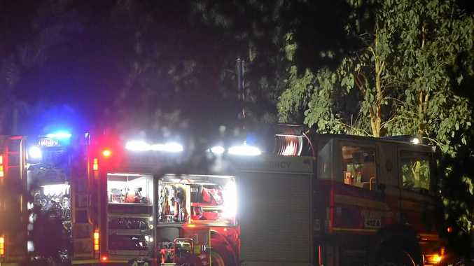 ON SCENE: Fire crews were called to the Cunningham Highway last night where a truck had rolled onto its side.