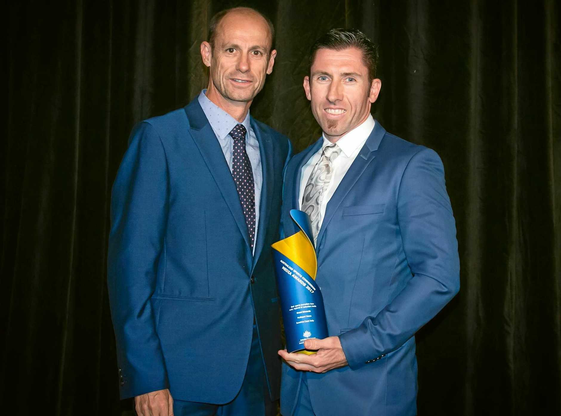 Marathon legend Steve Moneghetti presents Grant Edwards with the award for best sports journalism from rural, regional or suburban media at the Australian Sports Commission Media Awards.