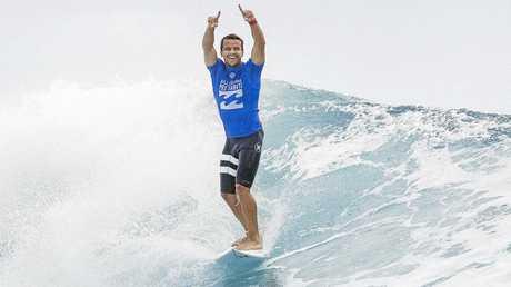 Julian Wilson celebrates after defeating Brazilian surfer Gabriel Medina of Brazil in the final of the Billabong Pro at Teahupo'o, Tahiti, last year.