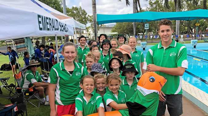 SWIMMING TO VICTORY: Emerald Seals Swim Club swimmers with mascot Flipper the Seal.