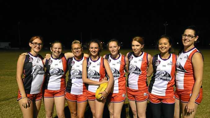 Bulldogs players Ella Baulch (left), Shaylee Rendell, Zeatta Baulch, Daniella Baulch, Courtney Milne, Deonie Crowther, Jasmine Habr, Kimberley Keam show off the new kit.