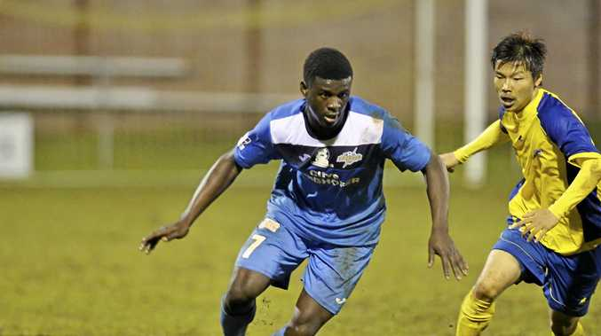IN ACTION: Kimba Kibombo takes on his Brisbane Strikers opponent.