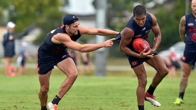DRENCHED: Melbourne Demons held an open training session at Maroochydore Mutlisport Complex yesterday. Dom Tyson (left).