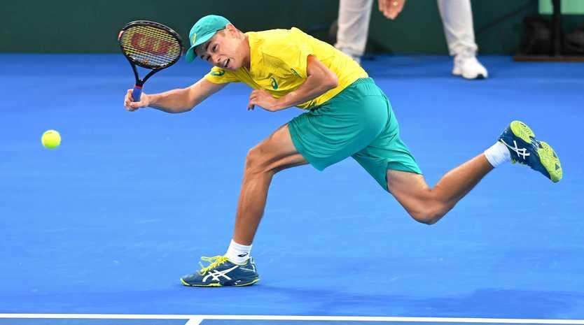Alex de Minaur in action against Alexander Zverev of Germany during their five-set Davis Cup World Group first round match at Pat Rafter Arena in Brisbane.