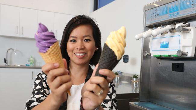 Procurement specialist Johanna Alfred with an ube and cheese flavoured soft serve flavours. Photo: Richard Gosling