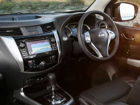 The Navara's piano-black finish and classier buttons give it an Interior edge.