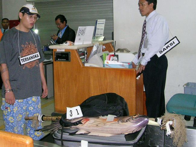 Andrew Chan re-enacting at Ngurah rai Airport the night he was arrested preparing to board a plane for Sydney.