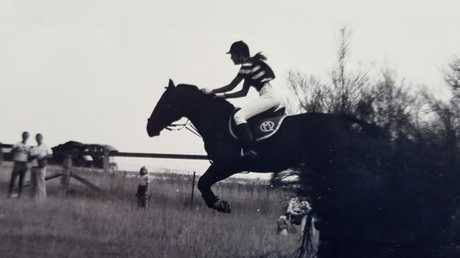 Sandy Bolton riding a horse in her younger days.