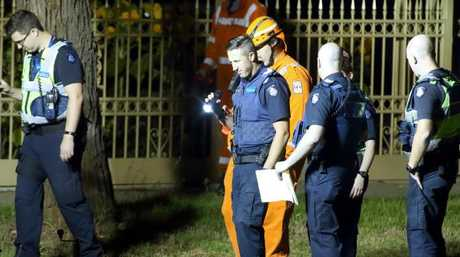 Police and SES complete a line search near the driveway where the woman was found. Picture: Patrick Herve