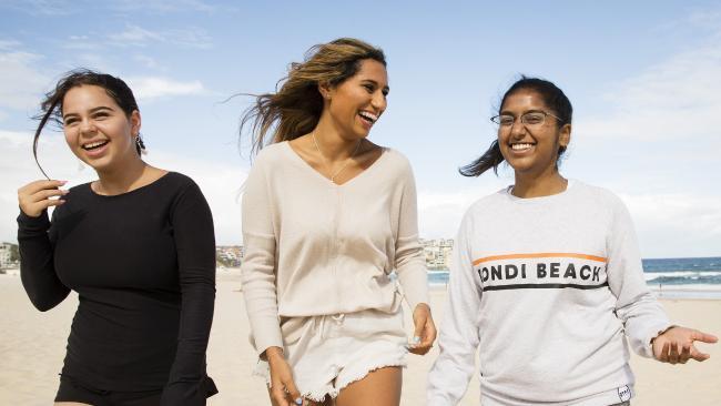 Teenaged friends (from left) Romy Glass, Zahara Jithoo and Jiveneshwari Govender discuss their experience of social media at Bondi Beach. Picture: Justin Lloyd