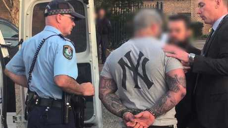 NSW Police arrest a second man during the Finks bikie clubhouse raid on Thursday. Picture: Strike Force Rednap
