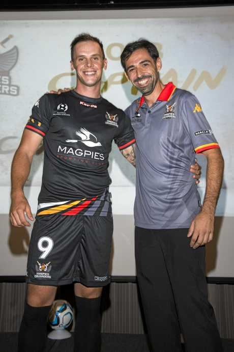Magpies Crusaders United captain Michael Lyall is congratulated by head coach Carlos Garcia Alejos at the club's season launch on Thursday, January 25.
