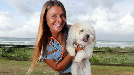 All vet Dr Caroline Orli does all day is drive around the Gold Coast and northern NSW putting down animals. Photo of her with Ollie. Photo: Richard Gosling