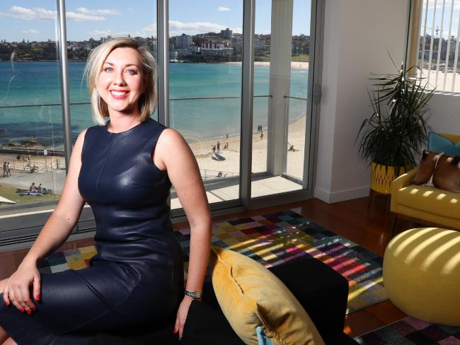 Vanessa Vartto pictured in her apartment in Bondi which is rented on Airbnb and will attract Qantas Frequent Flyer points. Picture Renee Nowytarger/The Australian