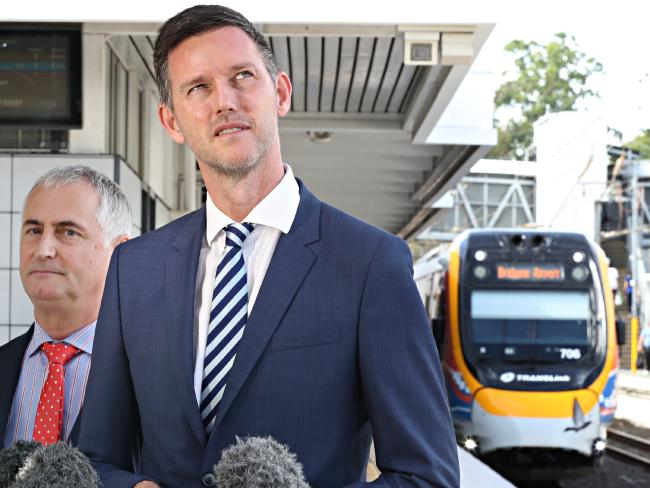 Transport Minister Mark Bailey at Bowen Hills station as an NGR unit rolls in.