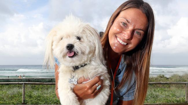 The Rainbow Vet Dr Caroline Orli is the Gold Coast's only vet solely dedicated to in-home pet euthanasia pictured with Ollie, 18 months, who is a long way from needing her services. Picture: Richard Gosling.