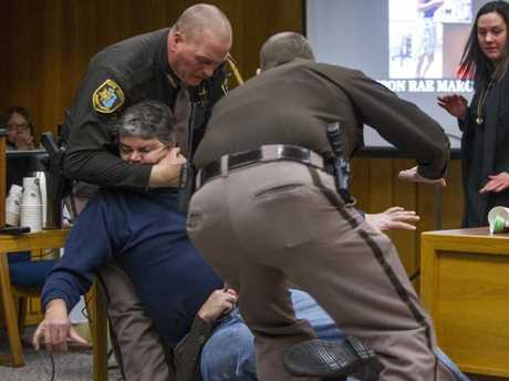 Sheriff's deputies pounce on the angry dad. Picture: Cory Morse/The Grand Rapids Press via AP