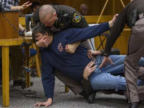 Eaton County Sheriff's deputies restrain Randall Margraves. Picture: Cory Morse/The Grand Rapids Press via AP