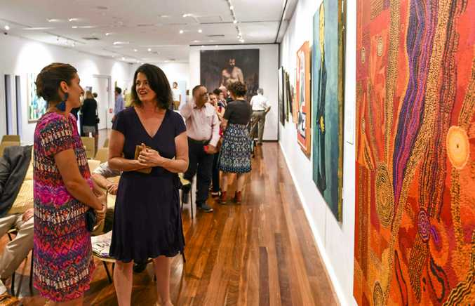 Guests take advantage of seeing Australia's premier portraiture prize the Archibald at the Grafton Regional Gallery.