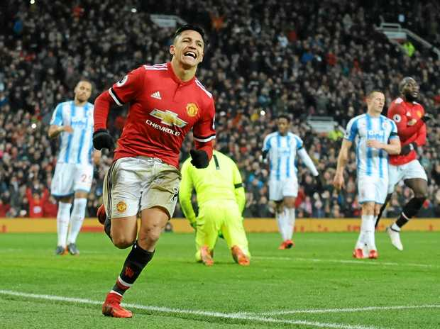epa06494178 Manchester Uniteds Alexis Sanchez celebrates scoring during the English Premier League soccer match between Manchester United and Huddersfield Town at Old Trafford in Manchester, Britain, 03 February 2018.  EPA/Rui Vieira EDITORIAL USE ONLY. No use with unauthorised audio, video, data, fixture lists, club/league logos 'live' services. Online in-match use limited to 75 images, no video emulation. No use in betting, games or single club/league/player publications.